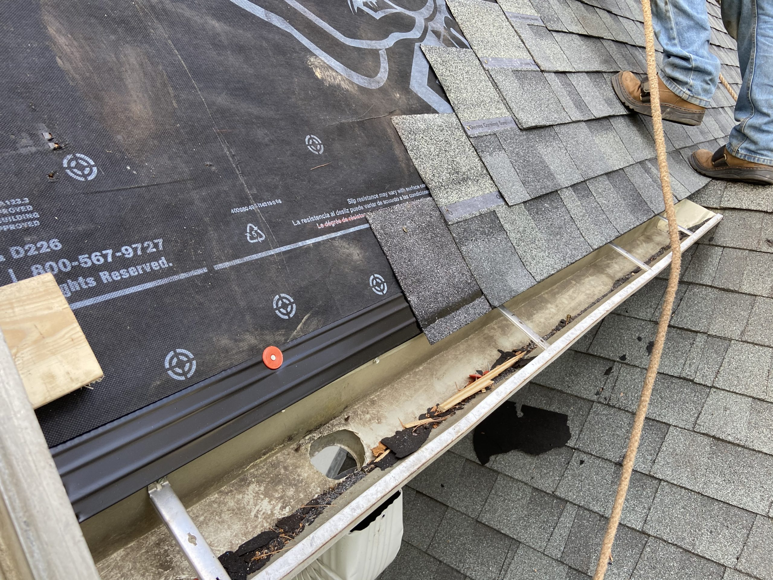 The outlook of the roof while the shingles are still being installed.