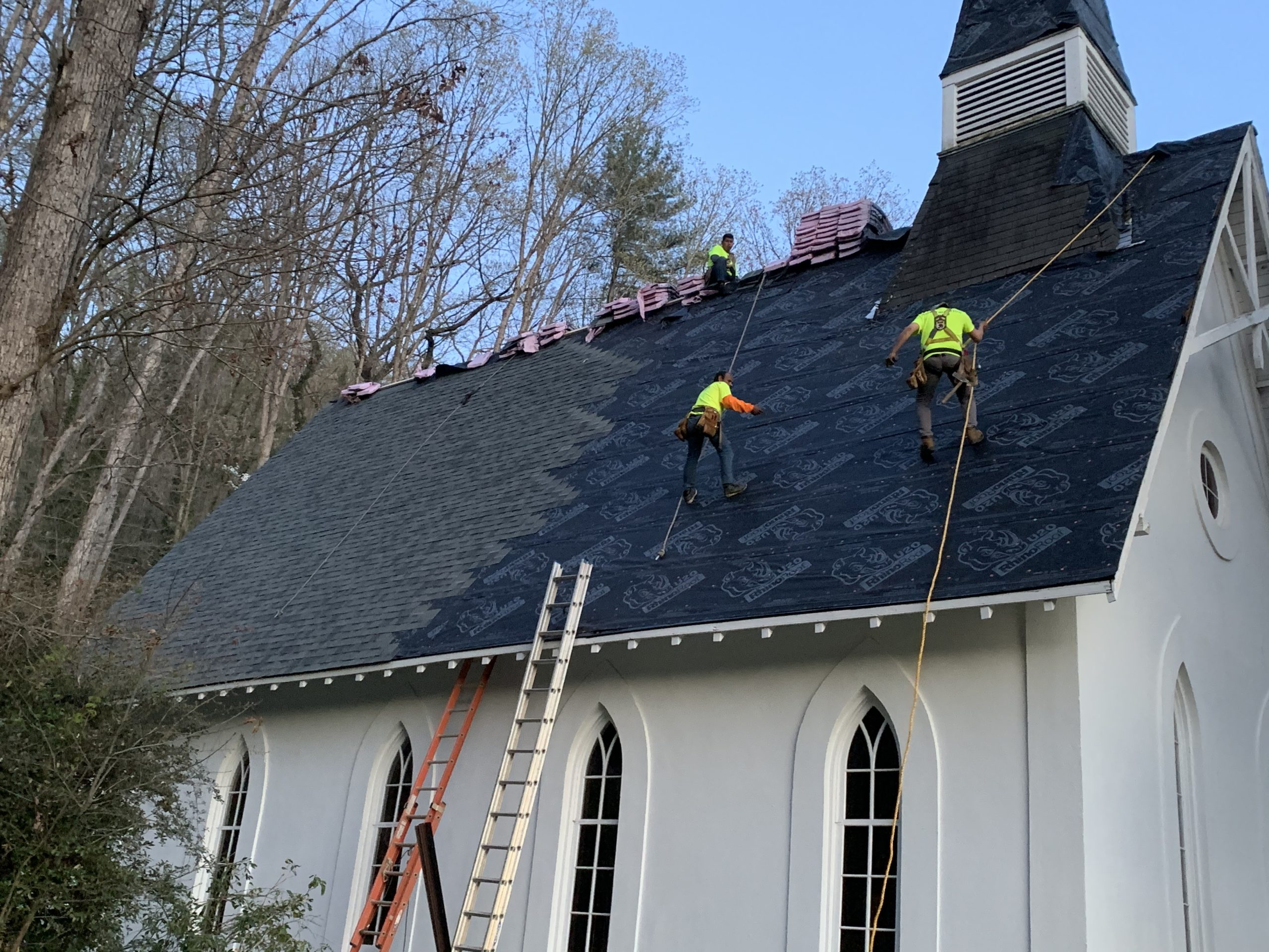 The roofing crew while installing the shingles.