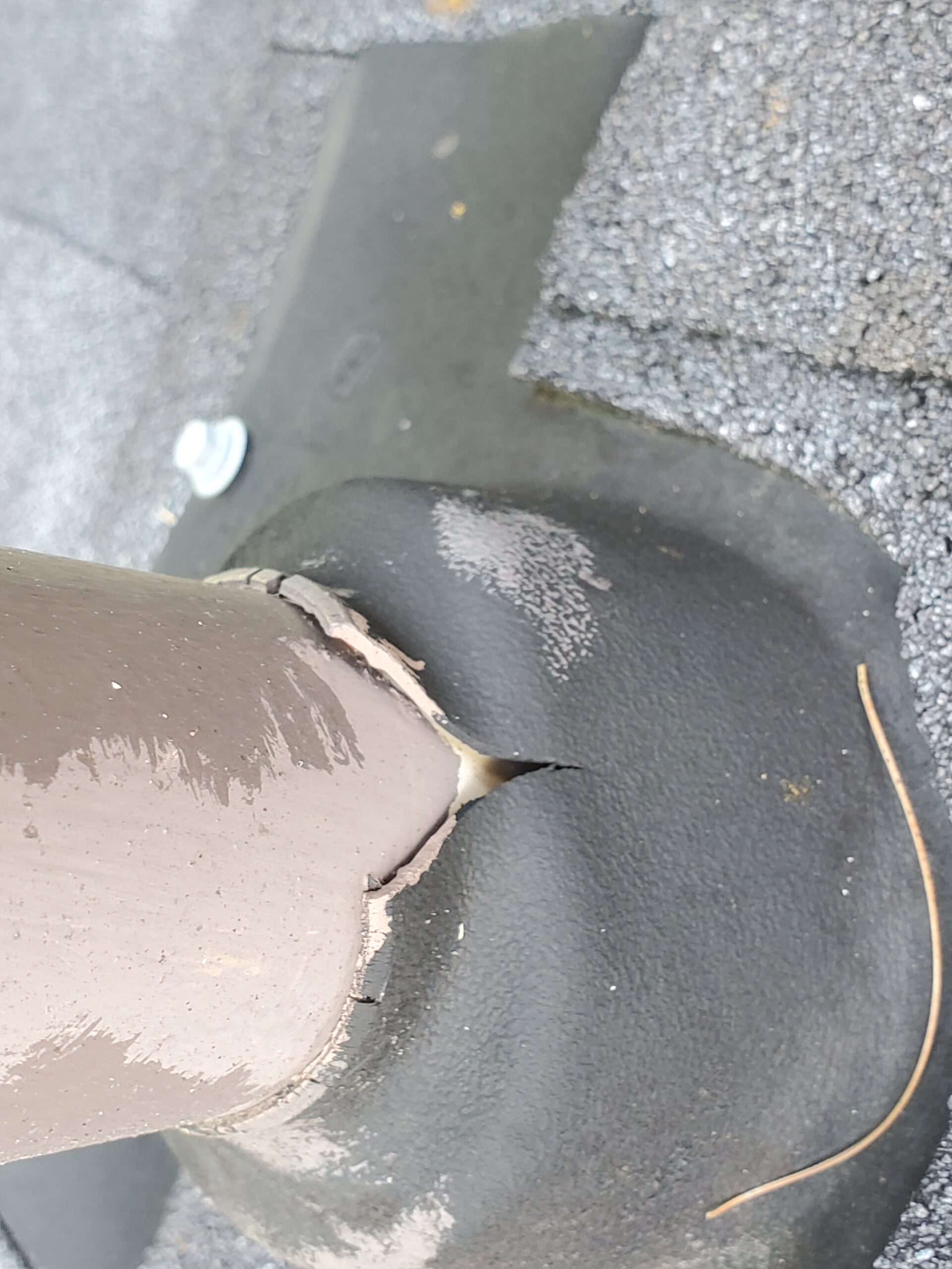 This is a picture of a plumbing boot on a roof and the rubber part is dry rotting in cracking