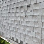 This is a picture of a Gray colored shingle roof and the shingles are becoming detached and sliding out from underneath each other