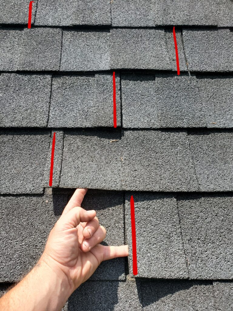 """This is a picture of a group of Gray shingles and the 6"""" stagger on the shingles is installed incorrectly"""