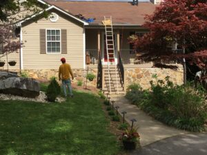 Installing new ridge vent and bronze gutters to home