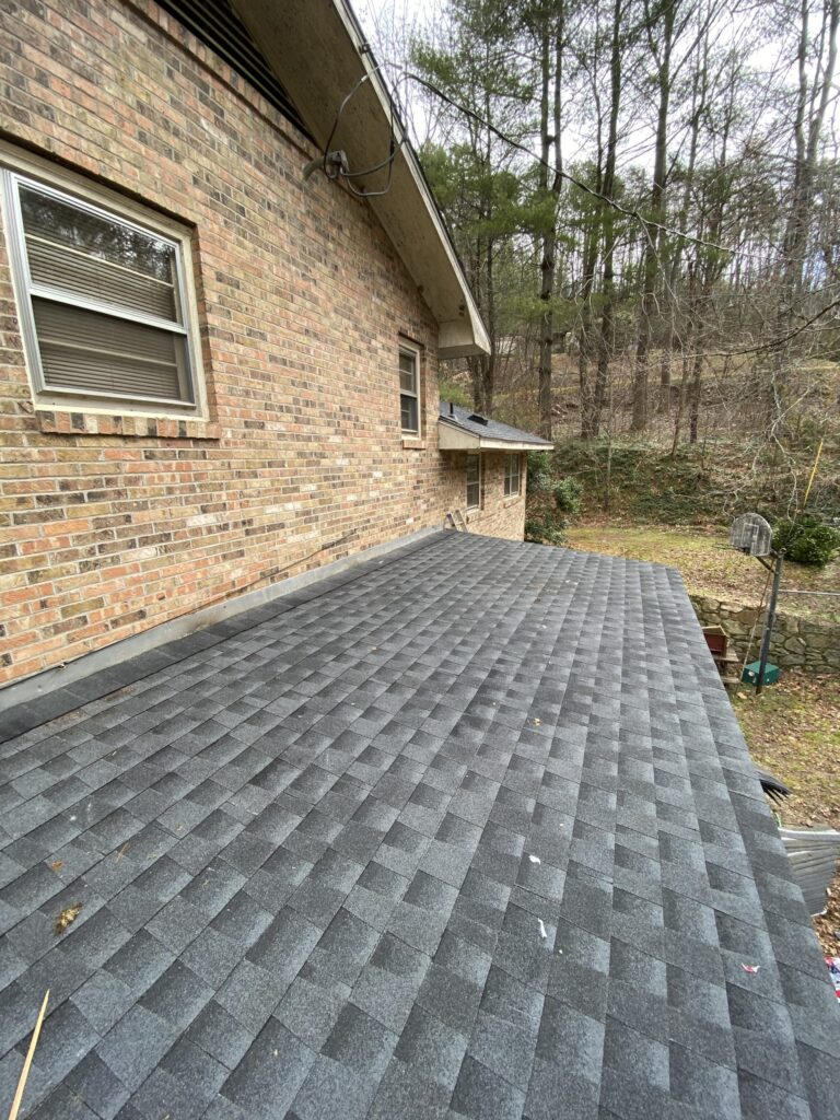 Roofing was already completed after we install the new shingles, new deck boards, and new rafters at the rear shed roof.