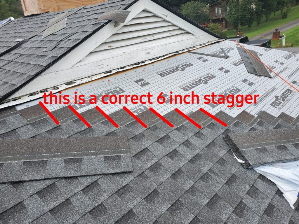 """This is a picture  Of shingles being installed on a roof and a diagonal 6"""" stagger with red lines marking each 6"""" stagger"""