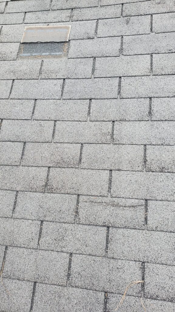These pictures show a grey shingle roof that has missing shingles all over the place.