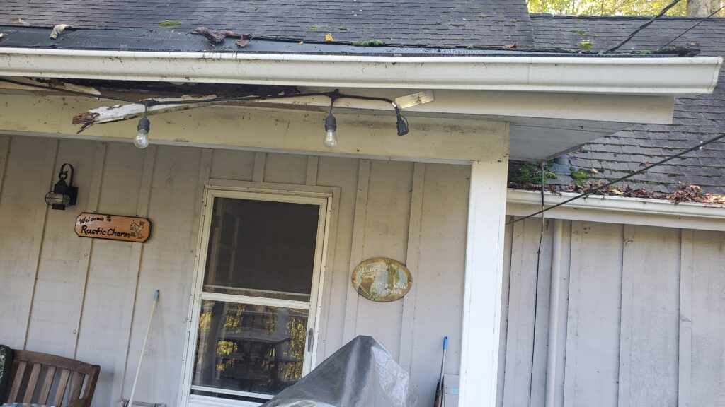 This is a picture of fascia boards that are breaking in falling apart due to rotted wood