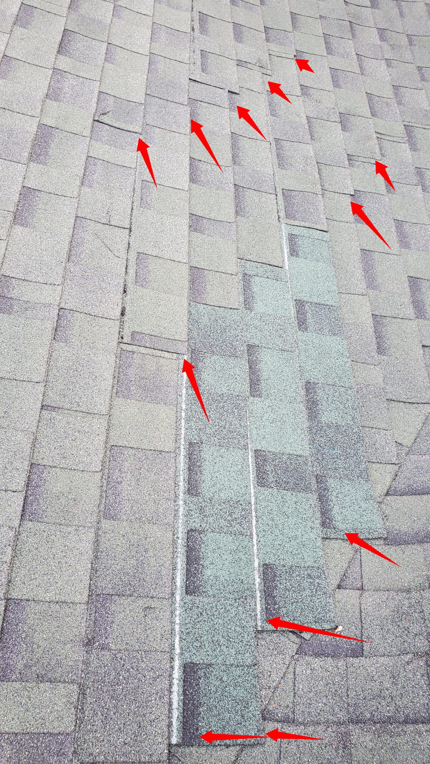 A picture of a roof with green shingles and red arrows pointing to the corners of the shingles.