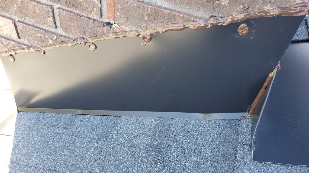 This is a picture of the chimney flashing on the roof.