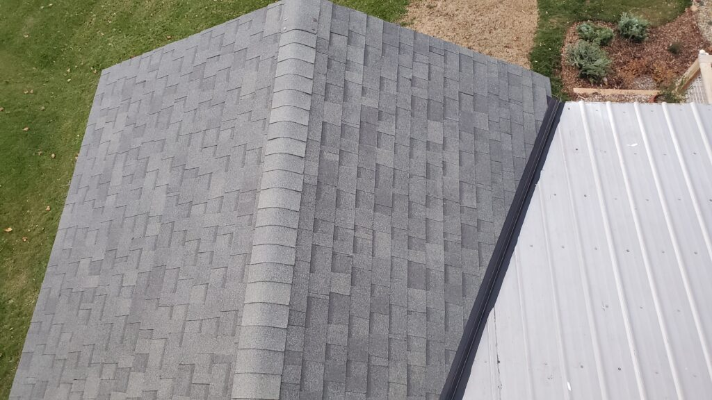 This is a view of the roof with gray shingles and the valley is pictured here.