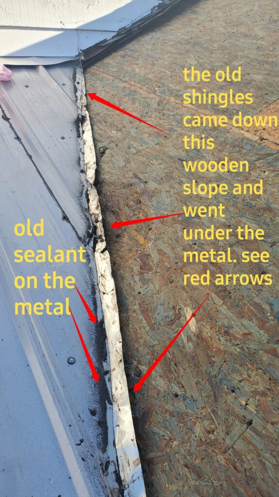 This is an image of the roof with exposed wood and metal.