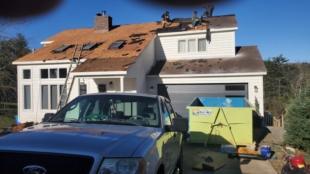 This is a picture of the roof with the shingles torn off.