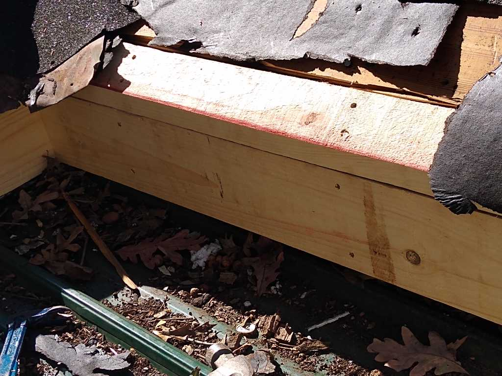 This is a picture of a 2 x 4 being added at the edge of a roof line