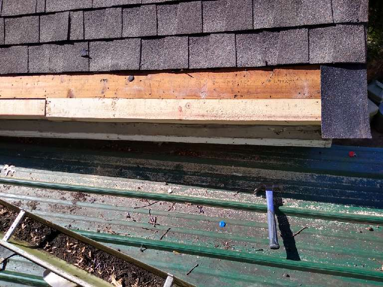 This is a picture showing edge of the roof where we are replacing boards that were rotten