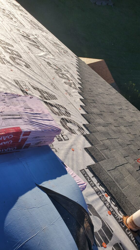 This is a picture of a shingle roof being installed