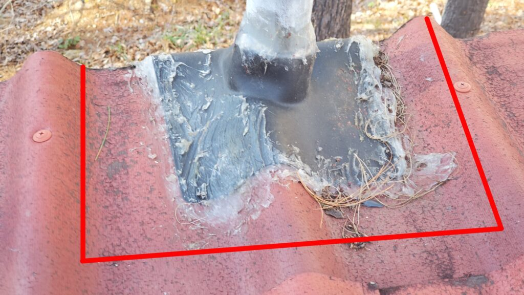 This is a picture of a red terracotta roof with a black pipe boot around a pipe in the roof. It also has a red line drawn around it.