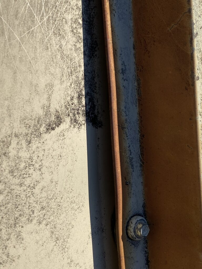 This is a view of a rusted metal panel on roof.