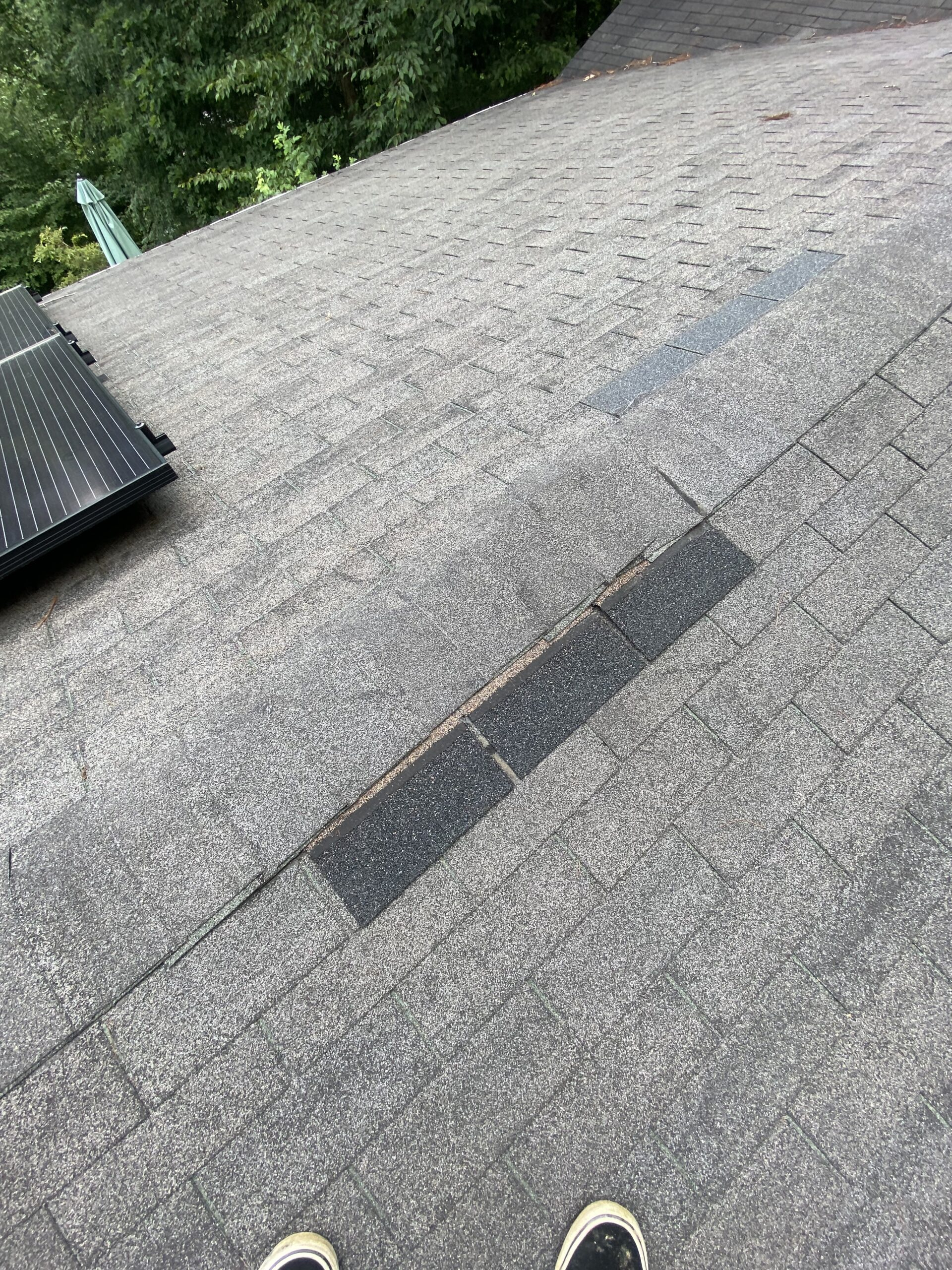 This is a picture of an attempted repair at a ridge cap
