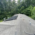 This is a picture of an old three tab roof wit solar panels