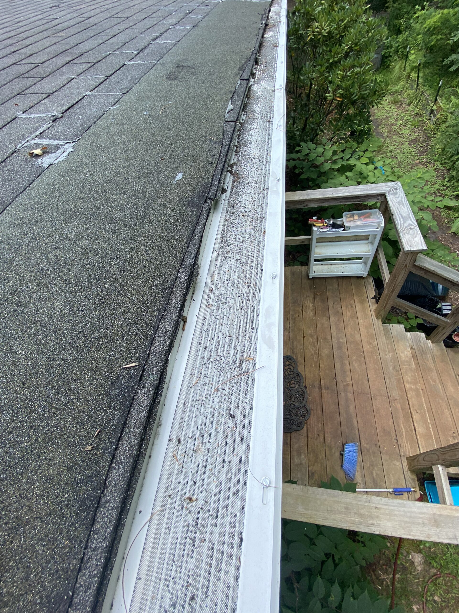 this is a picture of the edge of a roof with short shingles